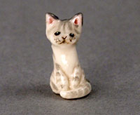 miniature ceramic cat figurine