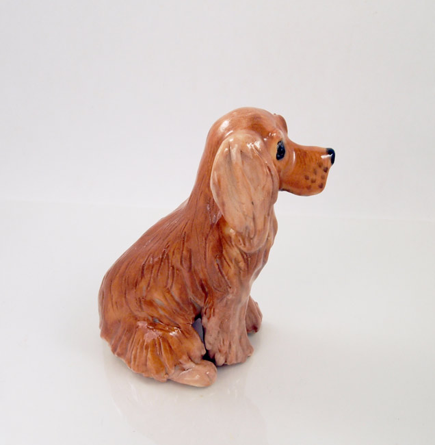 One of a kind ceramic dog sculptures and figurines